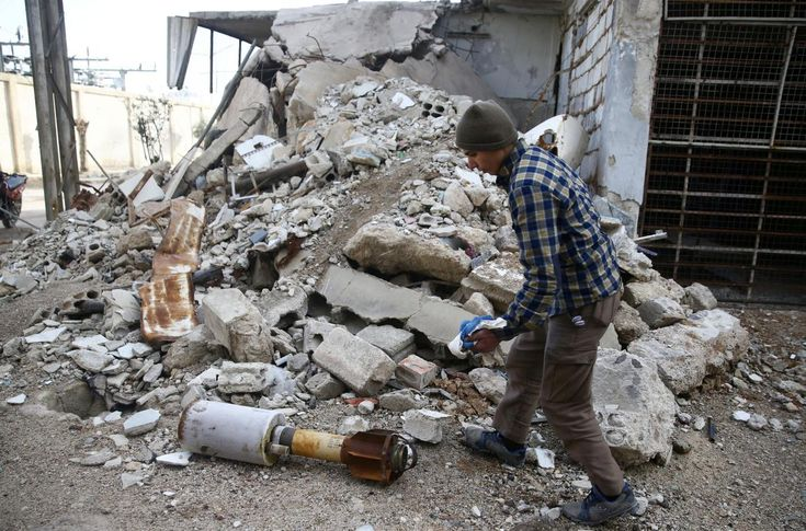 Air strikes pound Syria's last rebel strongholds, gas chokes civilians