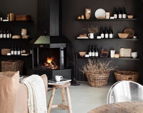Black is relaxing and cozy {you need light furniture and floors to really pull it off}