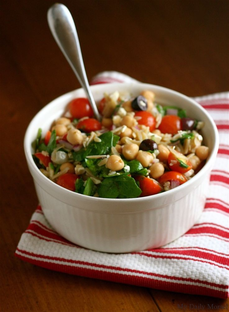 Dressing  3 tablespoons red wine vinegar  1 teaspoon dried oregano  1 clove garlic, minced  1/4 cup extra-virgin olive oil  Kosher salt  Freshly ground black pepper    Salad  1 cup orzo  1 (15 ounce) can chickpeas, drained and rinsed  1 cup baby spinach leaves, chopped  1/2 pint cherry tomatoes, halved  1/4 cup pitted kalamata olives, halved  1/4 cup crumbled feta cheese  1/2 red onion, diced