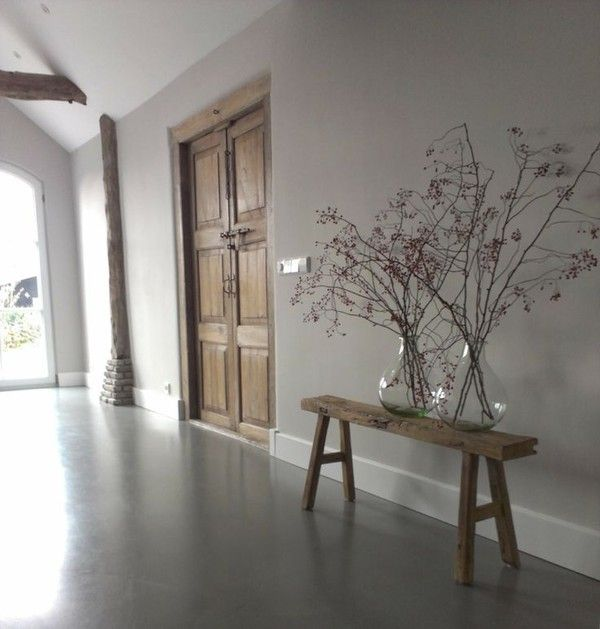 unique combo - dark floors, grey walls, white baseboards with rustic wooden…