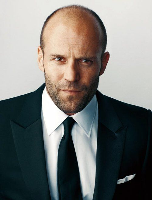 Jason Statham always looks good in a suit and tie.