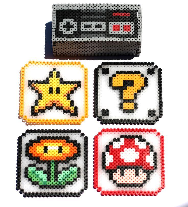Nintendo Controller Coaster Holder with Coasters - Perler Bead Coasters, Perler Bead Coaster Box, Nintendo Controller, Super Mario Coasters by CarafirasCreations on Etsy https://www.etsy.com/au/listing/280695828/nintendo-controller-coaster-holder-with