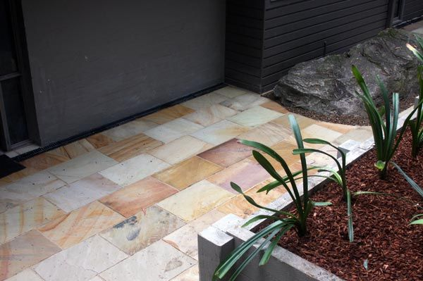 Himalayan Sandstone Courtyard in St. Ives Stone supplied by Gaia Stone and laid by Lone Pine Landscapes.