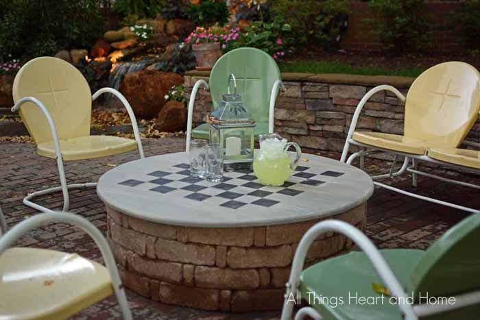 This DIY Fire Pit Cover does triple duty. Not only does it cover the fire pit when you're not using it, but it's a game board and a table for entertaining!.