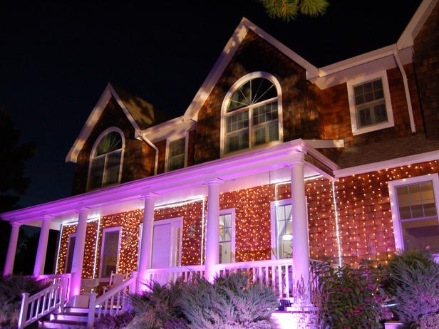Holiday lights projected on house