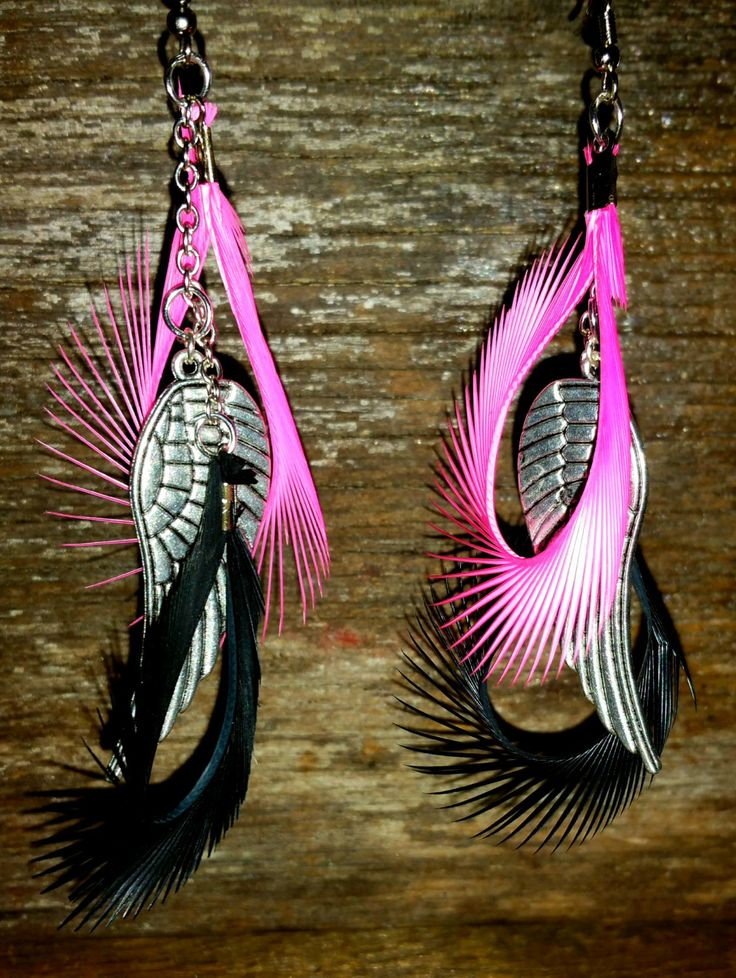 Gorgeous and stylish feather earrings! by Courts Prims on Etsy