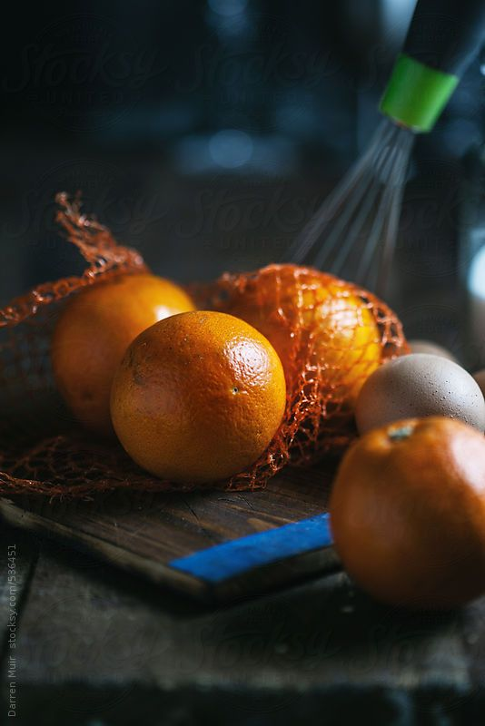Whole oranges on kitchen table. by Darren Muir.Available to licence on stocksy. DARRENMUIR20 for 20% discount on checkout. #discount #code #stocksy #stock #photography #Seville #orange #curd #dark