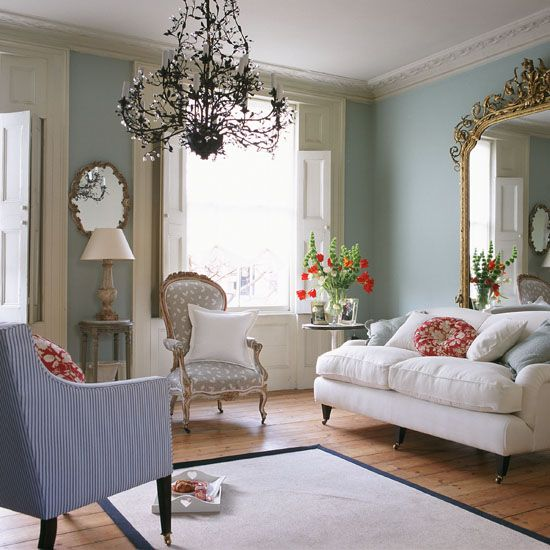 Pale green living room with lilac stripe chair