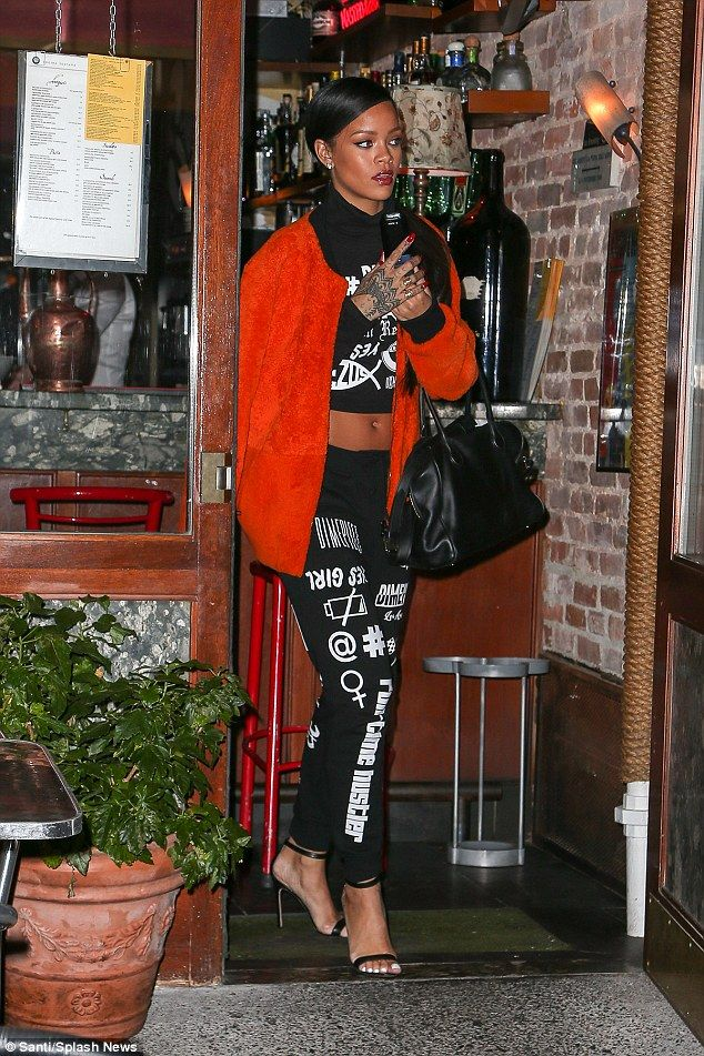 Rihanna dons a funky printed tracksuit and stilettos