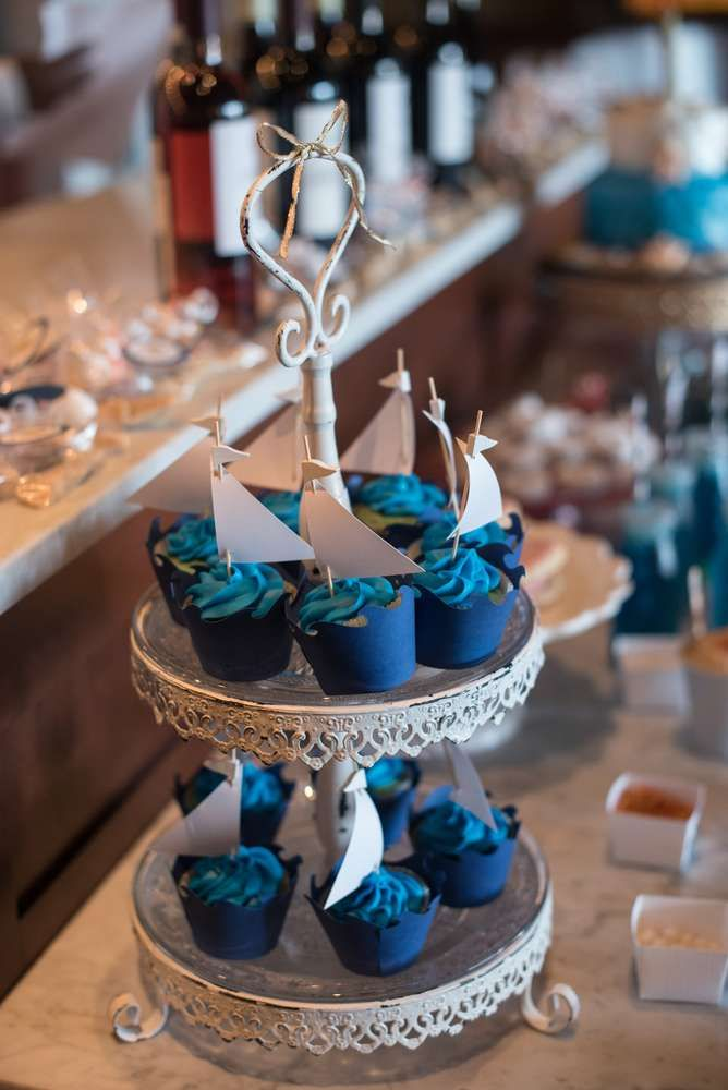 Sailboat cupcakes at a nautical birthday party! See more party ideas at CatchMyParty.com!