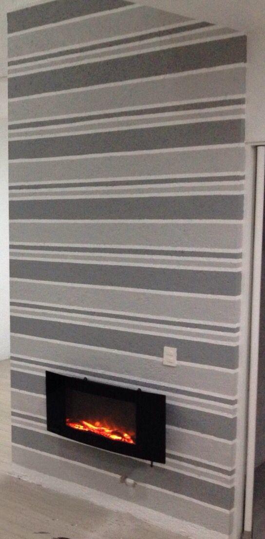Chimenea eléctrica empotrada, pared pintada