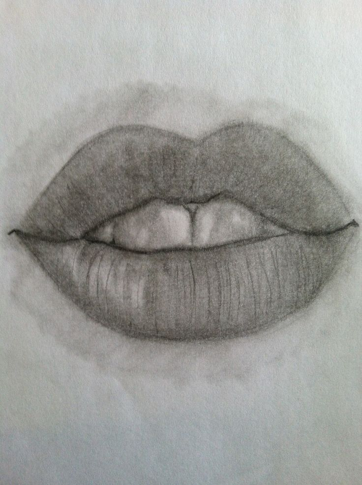 Sketch the basic shape of the lips shade in the darkest areas of the lips which tends to be the corners around the mouth and the inner areas