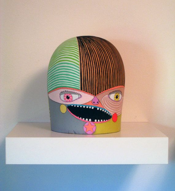 Hat head - acylic painted on a wooden hat stand by Jennifer Davis