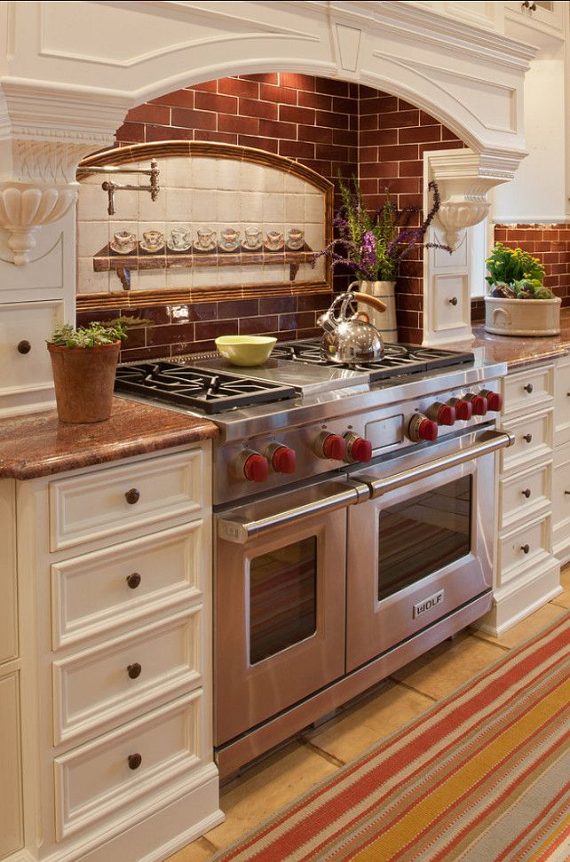 Not sold on the frew frew newels at the side of the stove, but love the recessed brick against the bright white.