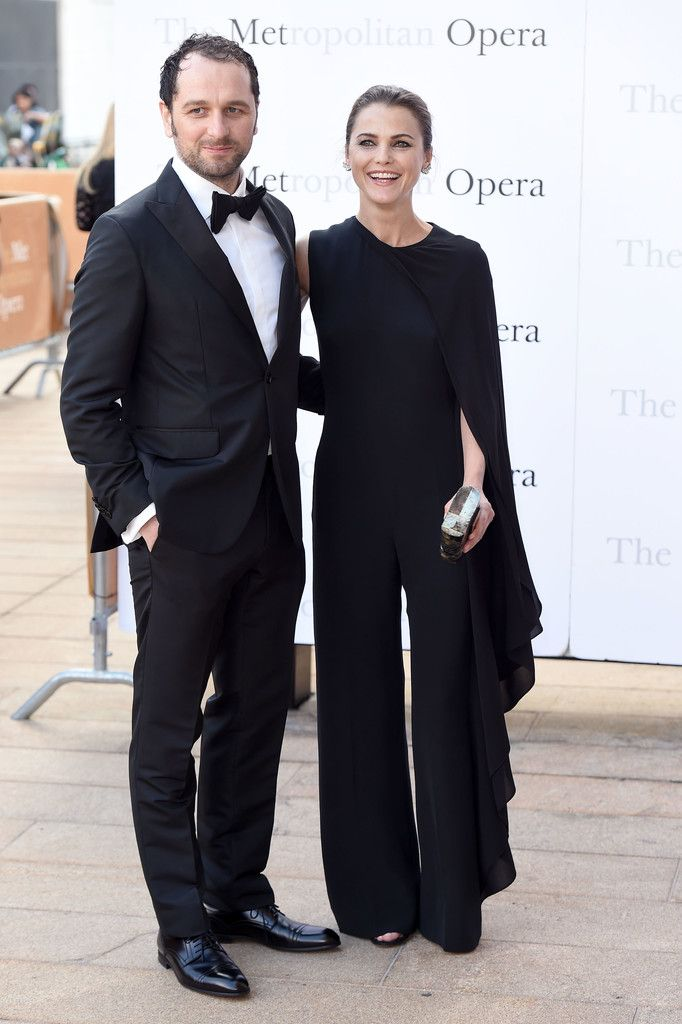 Keri Russell Jumpsuit - Keri Russell went for easy elegance in an asymmetrical black jumpsuit with cape detailing at the Met Opera opening performance of 'Tristan und Isolde.'