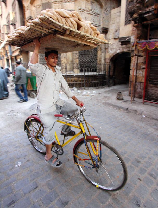 'Who was Asif?' 'In Egypt, you could get your bread delivered fresh by people who rode bikes. Asif rode on this yellow one and carried the bread on his head. In America, you just go to the store.'