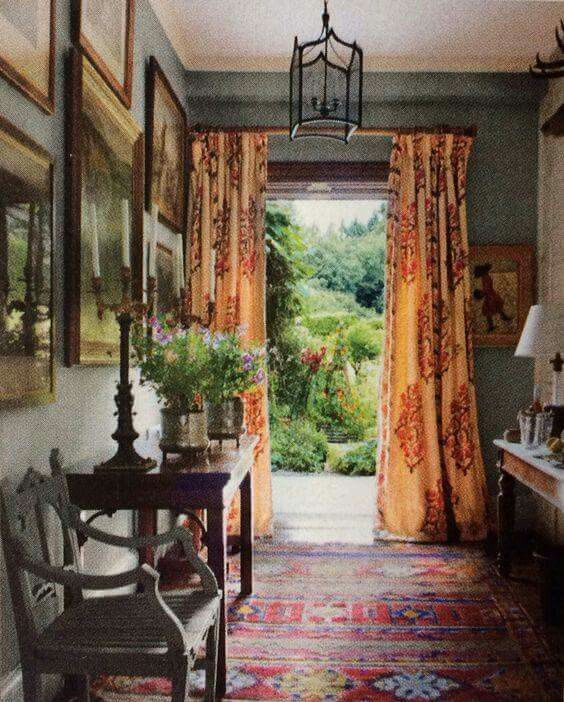Large #pattern on #draperies add a pretty and bold touch to this room.