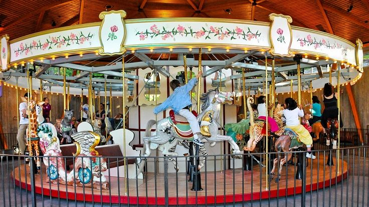 Rose Carousel with kids having fun!  Come out to our Light Up Event on Dec 1 - free rides. #butchartgardens
