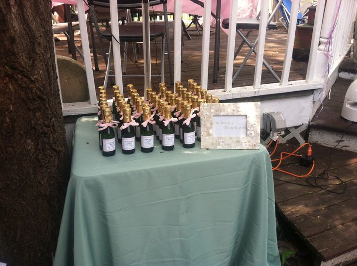 Champagne favors at Ready to Pop Baby Shower. Mini bottles ...