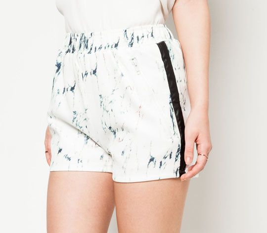 Abstract Zipper Shorts by Something Borrowed. Polyester combination fabric. Black and white color with marble pattern, side pocket with zipper, regular fit, black lined detail on the side of pants, look stylish. http://www.zocko.com/z/JFbcZ