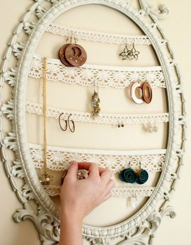 Take lace and string it between and old mirror - voila! Your own jewelry display.