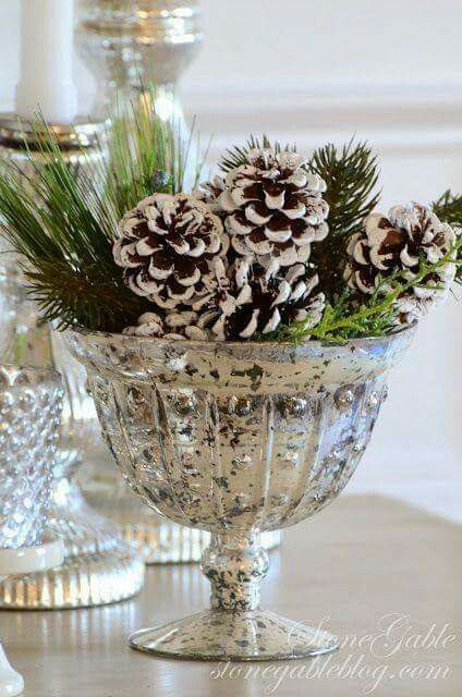 Christmas greens and pine cones in beautiful mercury glass.