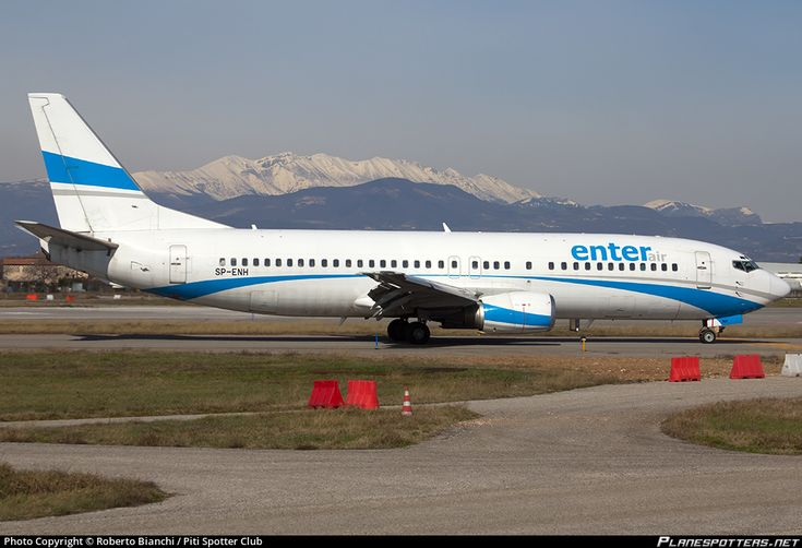 Enter Air Boeing 737-405 SP-ENH aircraft, skating at Italy Verona Villafranca (Valerio Catullo) Airport. 20/02/2016.