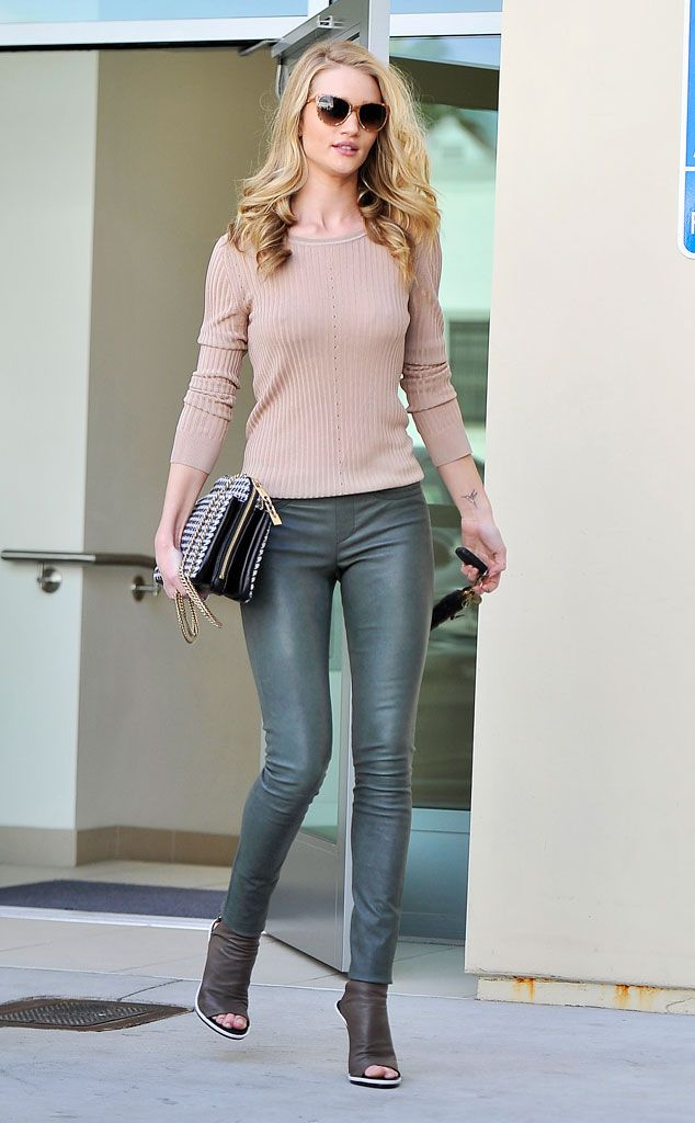 Rosie Huntington-Whiteley layers a cozy beige sweater over luxe Victoria Beckham leather pants, while shopping in Beverly Hills. She accessorizes with a chic houndstooth Chanel handbag and Balenciaga heels.