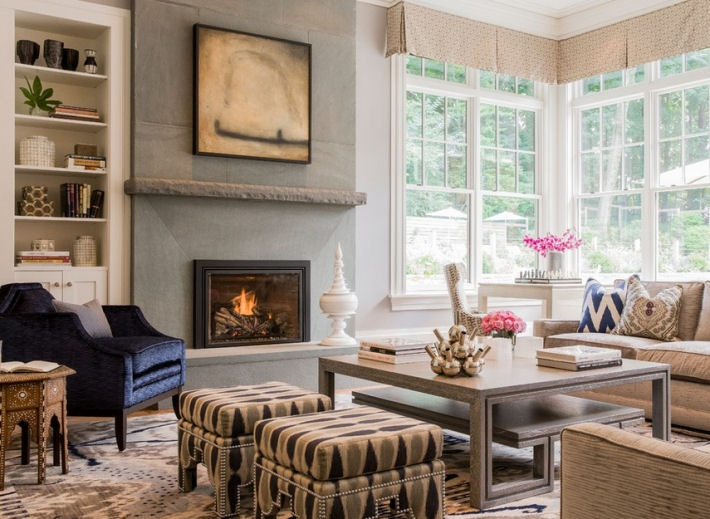 Fireplace Is Flanked By A Lounge Chair On One Side And Game Table The