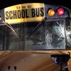 A man impersonating a police officer while escorting seven Massillon City School buses down Interstate 77 after a football playoff game caused two buses to crash, injuring 21 band members, officials said.