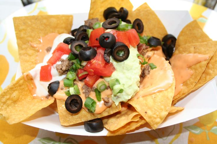 Game Day Nacho Bar, who wouldn't love that? http://themagicalslowcooker.com/2013/01/21/super-bowl-nacho-bar/