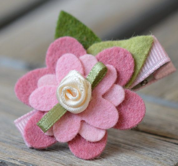 Sweet Little Rose Pink, Bubble Gum Pink and Cotton Candy Pink Wool Blend Felt Flower Hair Clip Great for Girls No Slip Grip Available. $4,00, via Etsy.