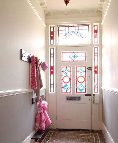 Stained glass front door and minton tiled floor