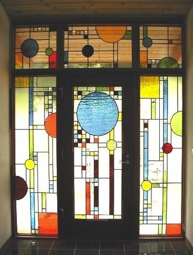 Stained glass - a traditional style of art which can be used to up cycle reclaimed or repurposed glass. The coloured light beams would make for an impressive entrance hall
