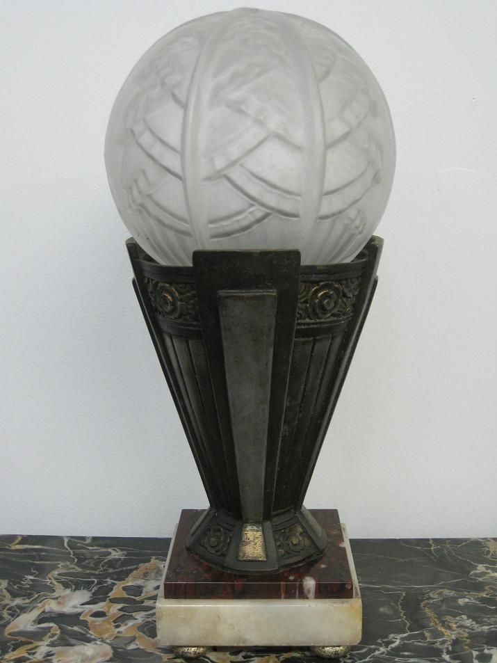 Pair of French Art Deco Table Lamps - A pair of French Art Deco Table Lamps with clear frosted molded round glass Shades enhanced by intricate geometric motif with polished details in great condition. Re-plating available upon request.  Reference #: TL8710  Measurement: Height: 14 in. (35.56 cm) Diameter: 6 in. (15.24 cm)