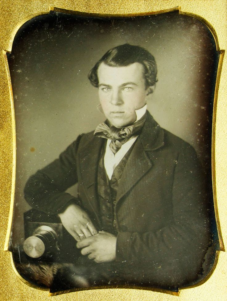 Daguerreotype of aa young photographer sitting beside his camera (Kaminski auctions)
