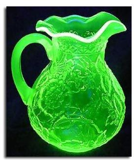 Vaseline Glass pitcher...glows under UV.  Contains uranium in the glass.