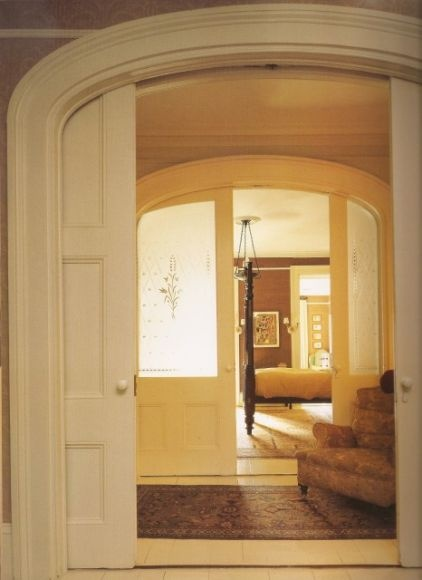 A series of pocket doors contribute to the enfilade effect in this traditional home. Grand openings and arches lead from one room to the next, making the whole house feel connected and open, despite the fact that each room is cordoned off.