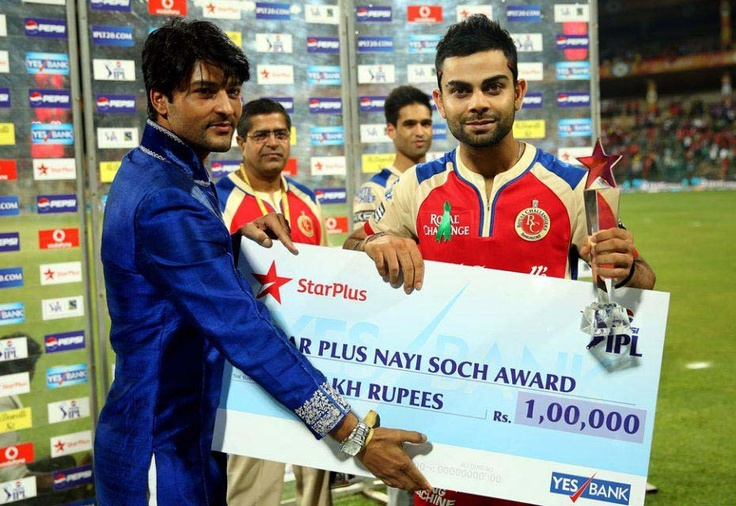 Royal Challengers Bangalore captain Virat Kohli receives ...
