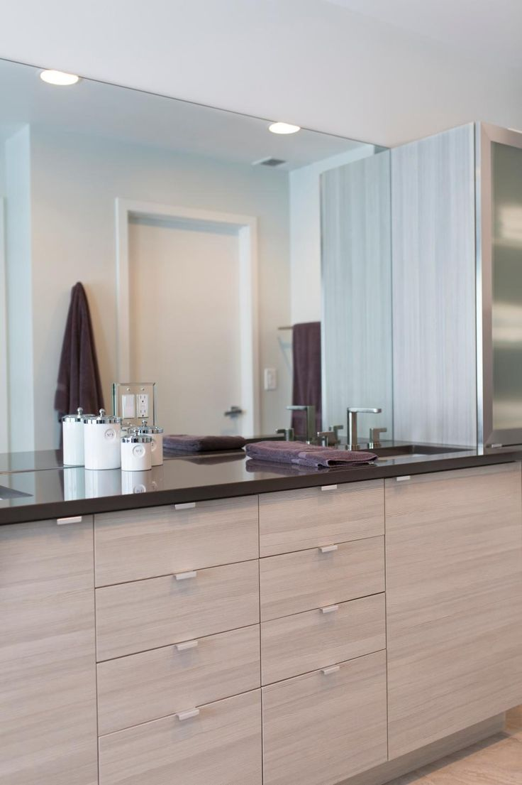 Hanging bookshelf design ideas that will revamp your home pennyroach - This Bright Bathroom Features A Streamlined Double Vanity