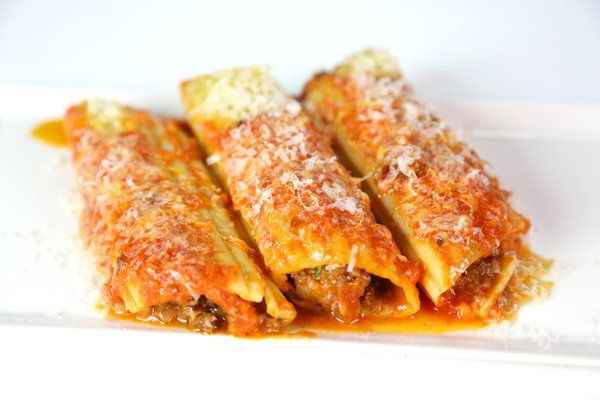 Baked Manicotti by Mario Batali Needed Major enhancement with spices, we like very bold flavors this recipe as is is bland.....pumped up spices and added pepper flakes/cayenne pepper for kick.