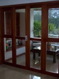 image result for puerta corrediza vidrio y madera