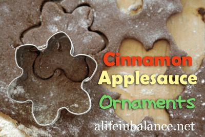 Years ago, I made cinnamon applesauce ornaments with my oldest son in the shape of Christmas trees. We still pull those scented ornaments out every Christmas. After reading 101 Days of Christmas by Mandi Ehrman, I decided to make another batch of cinnamon applesauce ornaments with my younger kids.  My 10 year old son made the cinnamon applesauce dough. Since we weren't eating the ornaments, I stuck to the cheap ground cinnamon, applesauce, and school glue.  He mixed everything up in a glass…