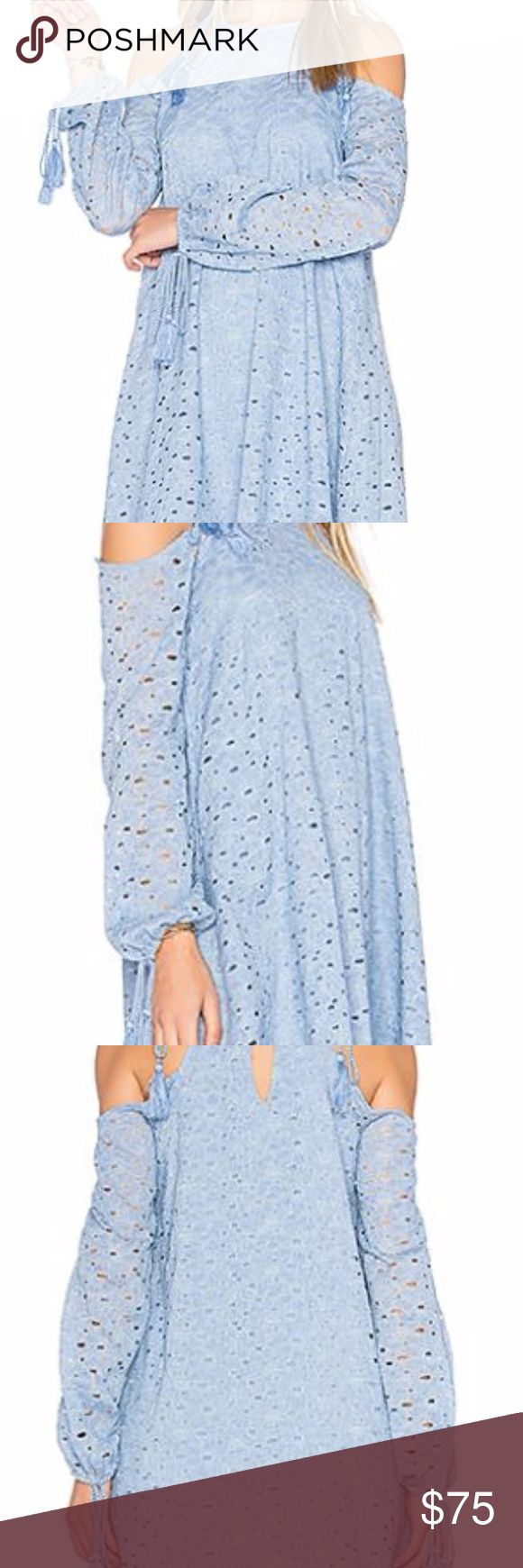 J.O.A. Blue Lace Cold Shoulder Dress Never worn, but tagless. Only selling because my arms are too big/not as slim as models, so it fits me weird. Currently being sold on revolve at $95 70% cotton , 30% nylon, Lining: 100% rayon Dry clean only Fully lined Braided tie shoulder straps with tassel accents Elasticized arm openings with tie accents Back keyhole with button closure Allover eyelet lace fabric…