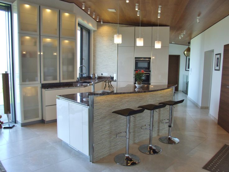 This large island combines plenty of work space with a striking raised seating area. #German #Kitchen #Raised #Seating #BreakfastBar
