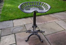 Tractor stool with adjustable height control