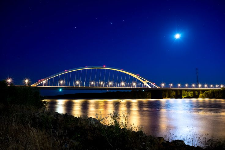 Danube at Night - The Danube river at night with the lights of the moon and the Pentele Bridge (Dunavecse, Hungary).