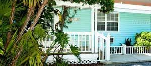 TRADEWINDS BEACH RESORT This turnkey furnished cottage is stylishly decorated with tropical furnishings and soft colors & has a full kitchen, bedroom & bath with tub/shower, a queen sleeper sofa in the living room & a priva te front porch.