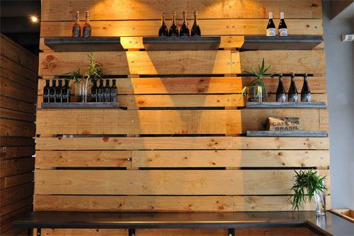 Jason Bakery, Cape Town. Wooden panel with floating shelves.