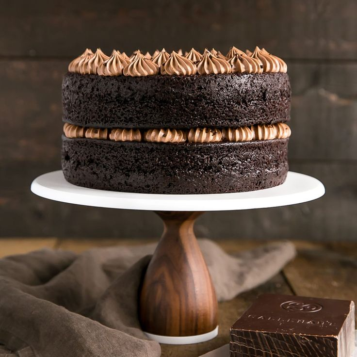 This French Silk Pie Cake is the dessert of your dreams!! Incredibly moist chocolate cake layers topped with an unbelievably silky chocolate frosting.